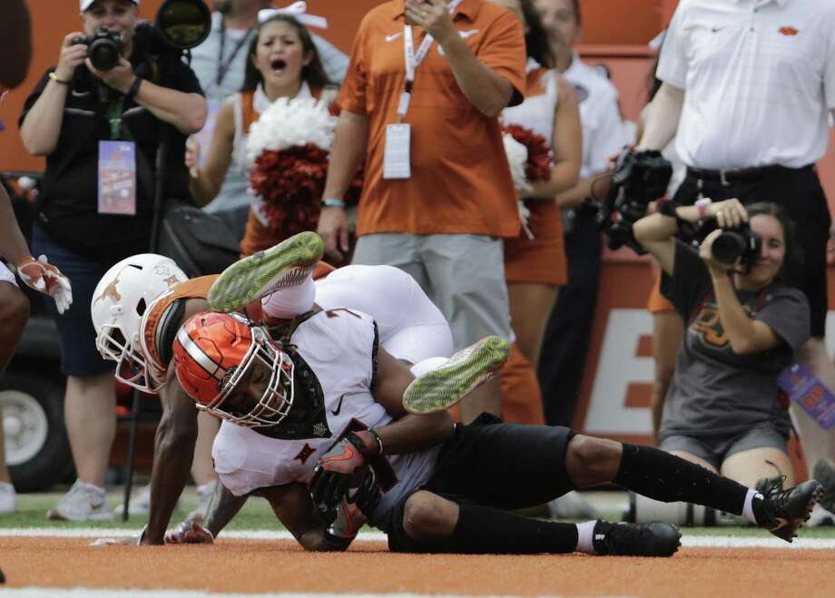 Oklahoma State's Ramon Richards — a former Brackenrdige High School sar — intercepts a pass intended for Dorian Leonard of the Texas Longhorns in overtime at Royal-Memorial Stadium on Oct. 21, 2017 in Austin. Photo: Tim Warner /Getty Images / 2017 Getty Images