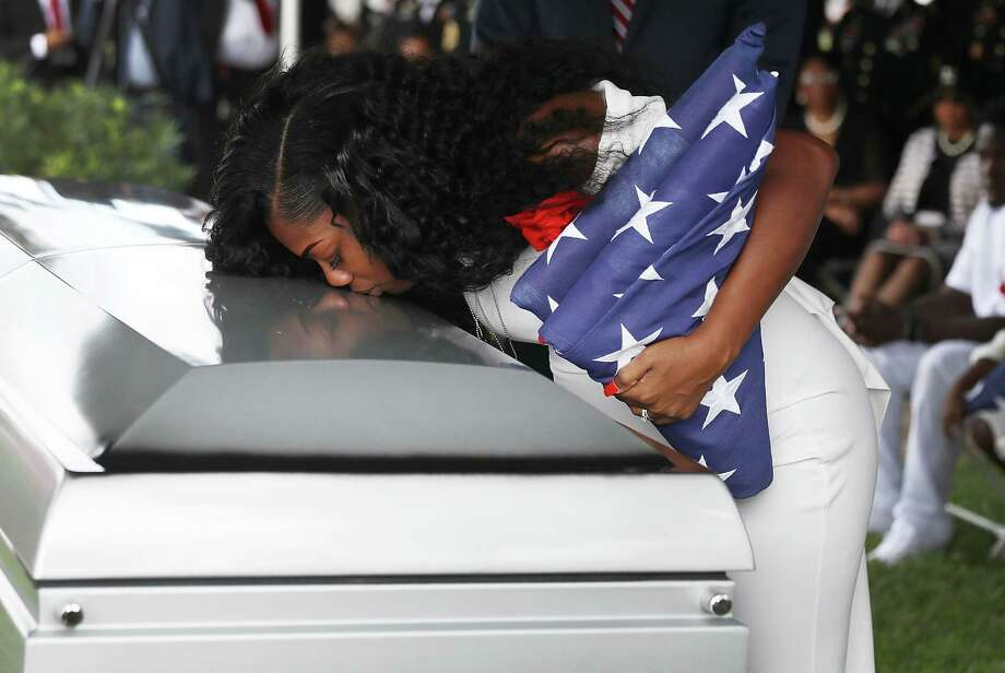 Myeshia Johnson kisses the casket of her husband U.S. Army Sgt. La David Johnson during his burial service in Hollywood, Fla. Photo: Joe Raedle, Staff / 2017 Getty Images