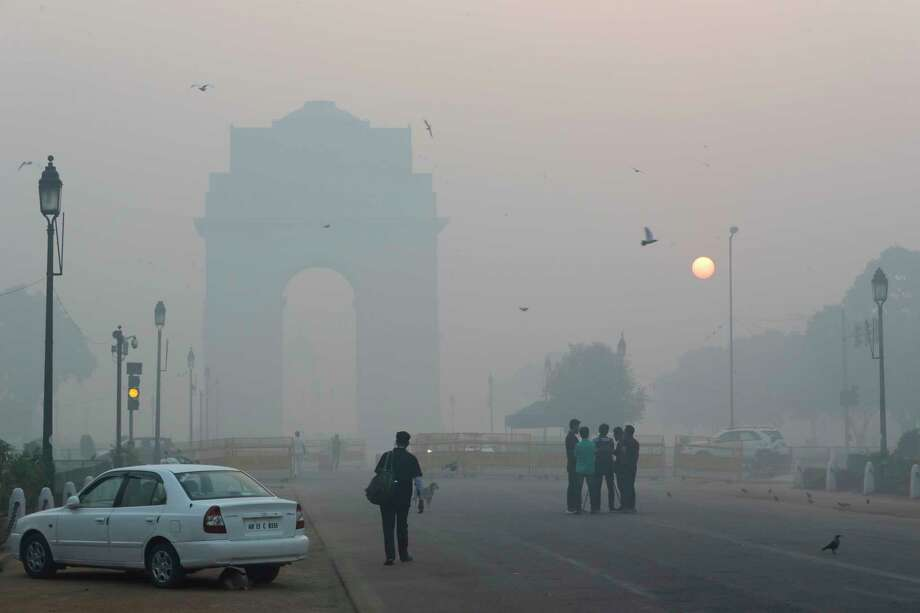 Delhi's landmark India Gate, a war memorial, is seen engulfed in morning smog a day after Diwali festival, in New Delhi, India, last week. Environmental pollution - from filthy air to contaminated water - is killing more people every year than all war and violence in the world. Photo: Manish Swarup, STF / Copyright 2017 The Associated Press. All rights reserved.