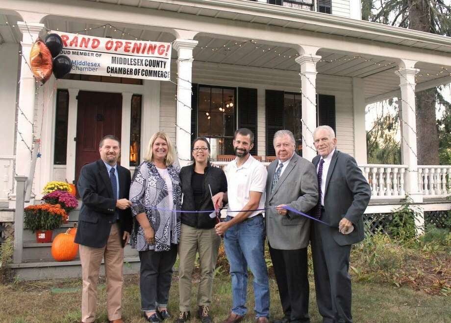 Whole Harmony Apothecary, 1572 Saybrook Road, Haddam, celebrated its two-year anniversary as a company with a ribbon cutting Oct. 12. From left are Middlesex County Chamber of Commerce Chairman Rick Morin, Haddam First Selectwoman Lizz Milardo, Owners Stacey Wood and Dave Soule, Chamber Vice Chairman Jay Polke and Chamber President Larry McHugh. Photo: Contributed Photo