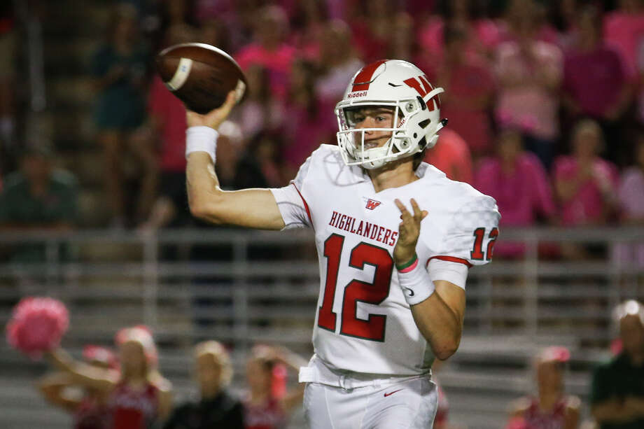 The Woodlands quarterback Quinton Johnson (12) throws a pass during the varsity football game against Oak Ridge on Friday, Oct. 20, 2017, at Woodforest Bank Stadium. (Michael Minasi / Houston Chronicle) Photo: Michael Minasi, Staff Photographer / © 2017 Houston Chronicle