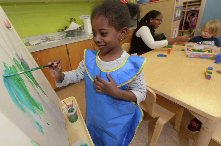 Preschooler Soleil Demapire paints during her ELLI class at Fox Run Elementary School Thursday, Oct. 18, in Norwalk. Norwalk Public Schools made waves when the Board of Education voted to implement the Early Language and Literacy Initiative (ELLI) curriculum in all of its preschools in accordance with Superintendent Steven Adamowskis Strategic Operating Plan for closing the achievement gap. The ELLI program was developed by Stepping Stones Museum for Children and Literacy How. Photo: Erik Trautmann / Hearst Connecticut Media / Norwalk Hour