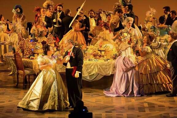 "Albina Shagimuratova, Violetta Valéry; Thomas Glass, Baron Douphol; HGO Chorus in HGO's ""La Traviata,"" 2017"