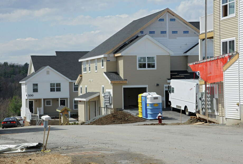 Construction on new housing is seen at Shelter Cove on Tuesday, April 21, 2015 in North Colonie, N.Y. (Lori Van Buren / Times Union) Photo: Lori Van Buren / 00031555A