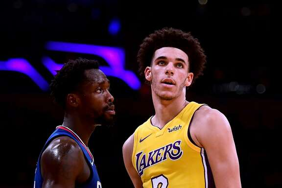 LOS ANGELES, CA - OCTOBER 19:  Lonzo Ball #2 of the Los Angeles Lakers is guarded by Patrick Beverley #21 of the LA Clippers during the first half of the Los Angeles Lakers home opener at Staples Center on October 19, 2017 in Los Angeles, California.  (Photo by Harry How/Getty Images)