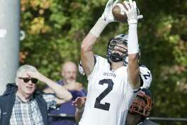 Wilton High School's Drew Phillips making a reception in a game against Ridgefield High School, played at Ridgefield. Saturday, Oct. 21, 2017