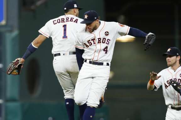 Houston Astros shortstop Carlos Correa (1) and center fielder George Springer (4) celebrate at the end of the ninth inning of Game 6 of the ALDS at Minute Maid Park, Friday, Oct. 20, 2017, in Houston. ( Karen Warren / Houston Chronicle )