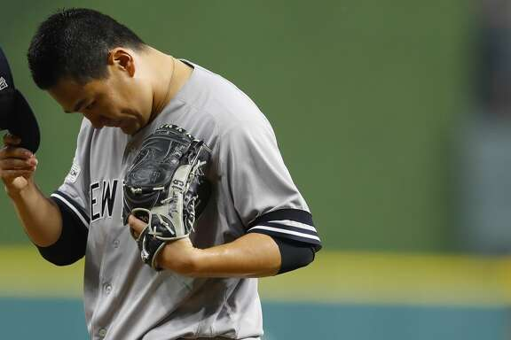 New York Yankees starting pitcher Masahiro Tanaka (19) tips his cap after a strike out to end his half of the fourth inning of Game 1 of the ALCS at Minute Maid Park on Friday, Oct. 13, 2017, in Houston. ( Brett Coomer / Houston Chronicle )
