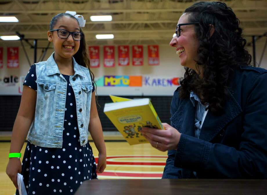 Yanneli Garza, 10, reacts after her favorite author Victoria Jamieson signs her copy of Roller Girl during the seventh annual Tweens Read book festival on Saturday,  in South Houston. Photo: Annie Mulligan, Freelance / @ 2017 Annie Mulligan