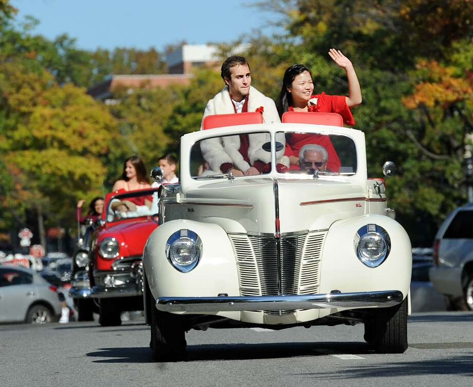 The Greenwich High School Homecoming King, Romano Orlando, left, and Queen, Calla Bai, right, both GHS seniors, rode in a convertible car during the GHS Homecoming parade on Greenwich Avenue, Greenwich, Conn., Saturday morning, Oct. 21, 2017. Photo: Bob Luckey Jr. / Hearst Connecticut Media / Greenwich Time