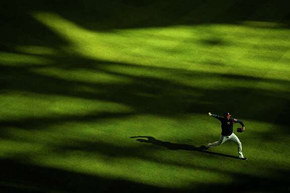 Houston Astros players warm up before the Houston Astros take on the New York Yankees in Game 7 of the ALCS at Minute Maid Park Saturday, Oct. 21, 2017 in Houston.