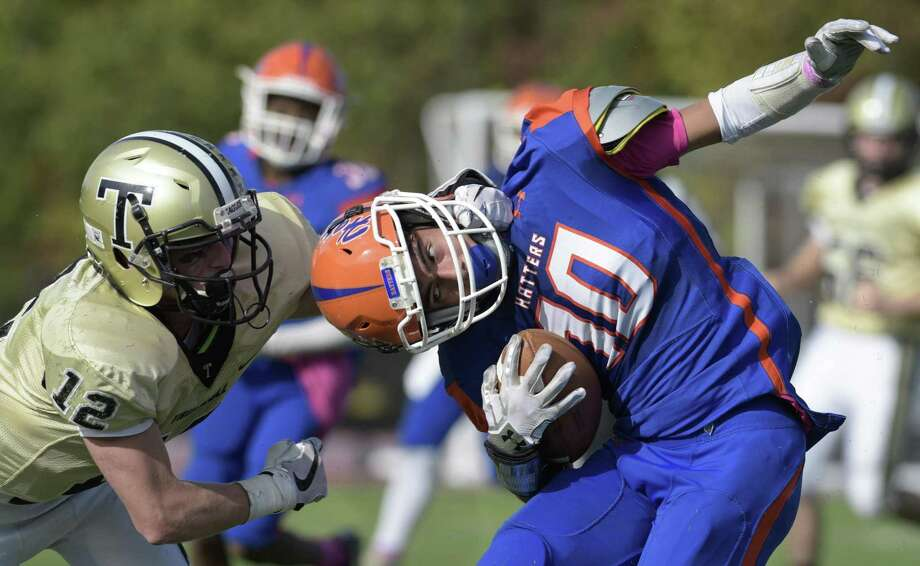 Danbury's Joe Merhi (10) is dragged out of bounds by Trumbull's Ryan Cranston (12) after catching a pass in the football game between Trumbull and Danbury high schools, Saturday afternoon, October 21, 2017 at Danbury High School, Danbury, Conn. Photo: H John Voorhees III / Hearst Connecticut Media / The News-Times