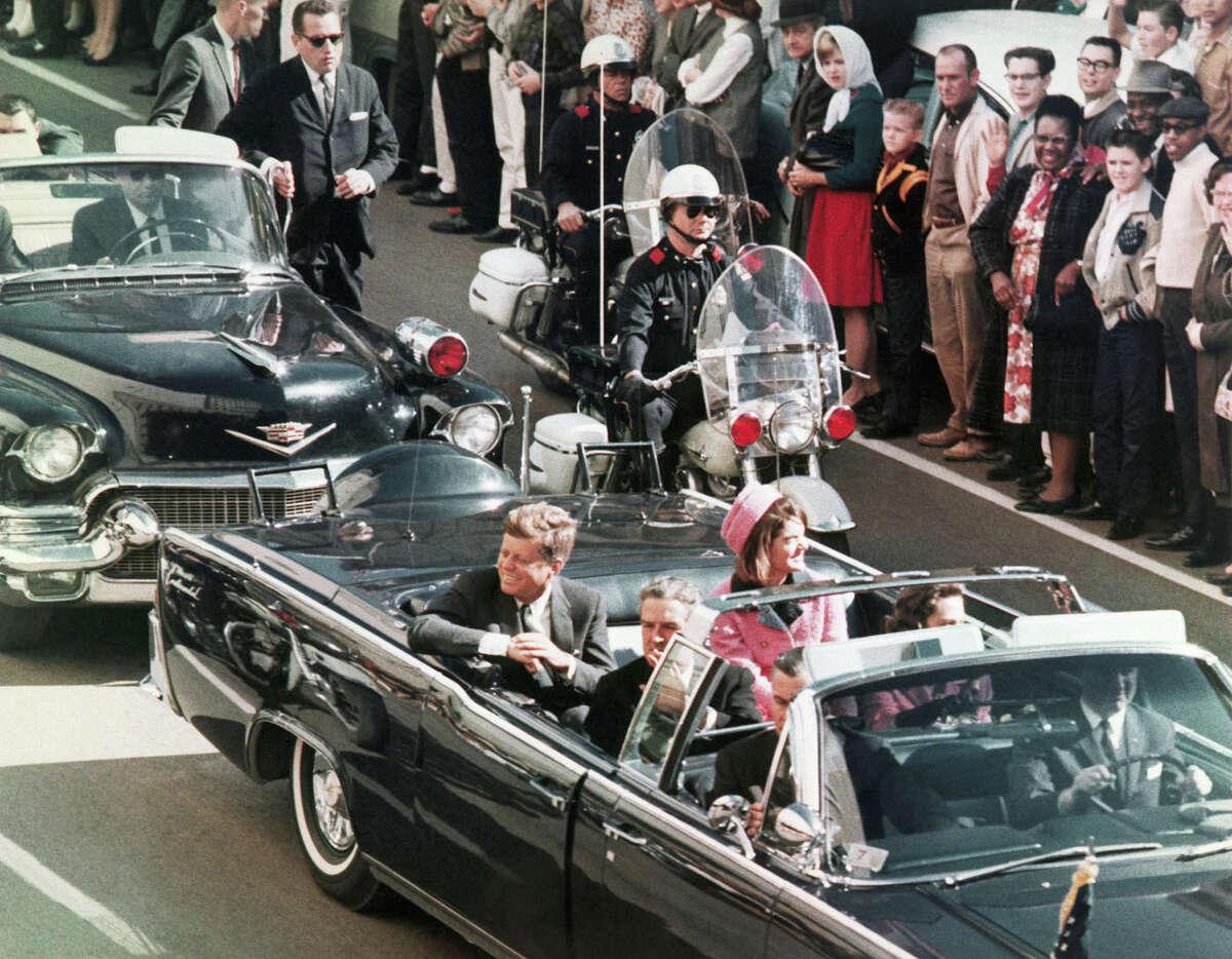 President John F. Kennedy's motorcade travels through Dallas on Nov. 22, 1963.