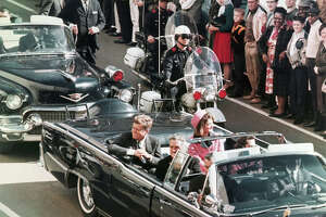 In this Nov. 22, 1963 file photo, President John F. Kennedy's motorcade travels through Dallas.  (AP Photo/PRNewsFoto/Newseum, File) THIS CONTENT IS PROVIDED BY PRNewsfoto and is for EDITORIAL USE ONLY