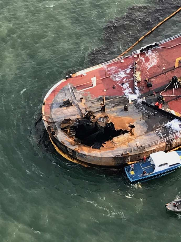 Two crew members are missing and oil is spilling about 3 miles off the coast of Port Aransas after a barge caught fire Friday afternoon, according to the U.S. Coast Guard. Photo: U.S. Coast Guard District 8