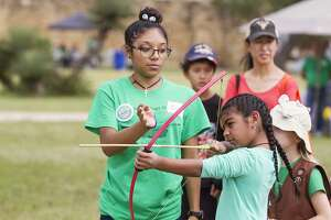 Maddi Rios, 8, shoots an arrow Saturday as part of Archeology Day at Mission San José.