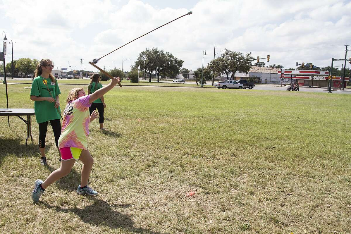 Addison Traylor, 10, throws an atlatl, a launcher used by early modern humans, Saturday at Mission San José, Saturday, Oct. 21, 2017.