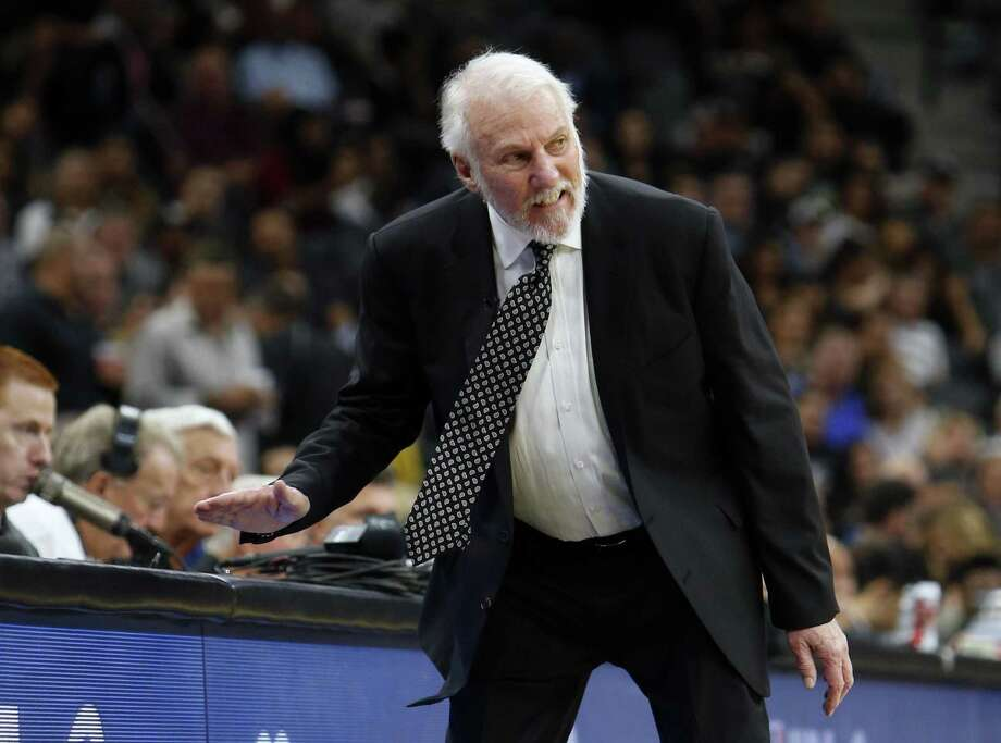 Spurs Coach Gregg Popovich reacts angrily to a call in the season opener against the Minnesota Timberwolves at AT&T Center. Readers, pro and con, continue to voice their opinions on the coach and his controversial comments. Photo: Ronald Cortes /Getty Images / 2017 Getty Images