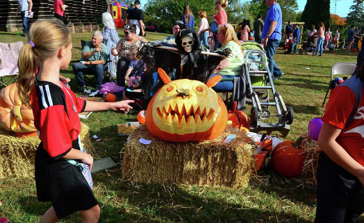 The Boothe Park Commission and the Town of Stratford host the annual Great Pumpkin Festival held at Boothe Memorial Park in Stratford, Conn. on Saturday Oct. 21, 2017. The main attraction was a children's costume parade. Along with the parade the festival included a pumpkin carving contest with prizes, DJ music, games, crafts, face painting, refreshments, a pie baking contest, a scarecrow judging contest, horse-drawn hayrides, the roaming railroad, and tours through the various historic buildings at the park, including tours of the Model Train Museum and Observatory. Bunnell High School STAGE theater group performed skits and costumed actors from the Players at Putney Gardens strolled the grounds. New to the festival this year was a Falconer Show and Live Animal Experience.