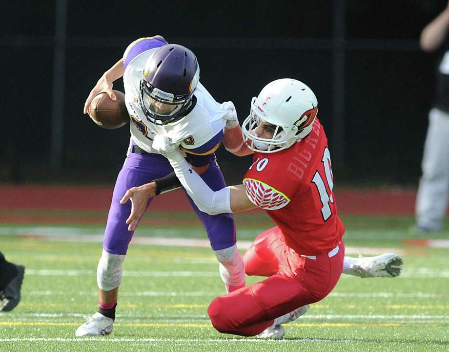 Tyler Blizzard (#10) of Greenwich, right, sacks Westhill quarterback AJ Laconna during the high school football game between Greewich High School and Westhill High School at Greenwich, Conn., Saturday, Oct. 21, 2017. Greenwich defeated Westhill by a score of 60-15. Photo: Bob Luckey Jr. / Hearst Connecticut Media / Greenwich Time
