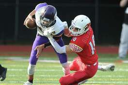 Tyler Blizzard (#10) of Greenwich, right, sacks Westhill quarterback AJ Laconna during the high school football game between Greewich High School and Westhill High School at Greenwich, Conn., Saturday, Oct. 21, 2017. Greenwich defeated Westhill by a score of 60-15.