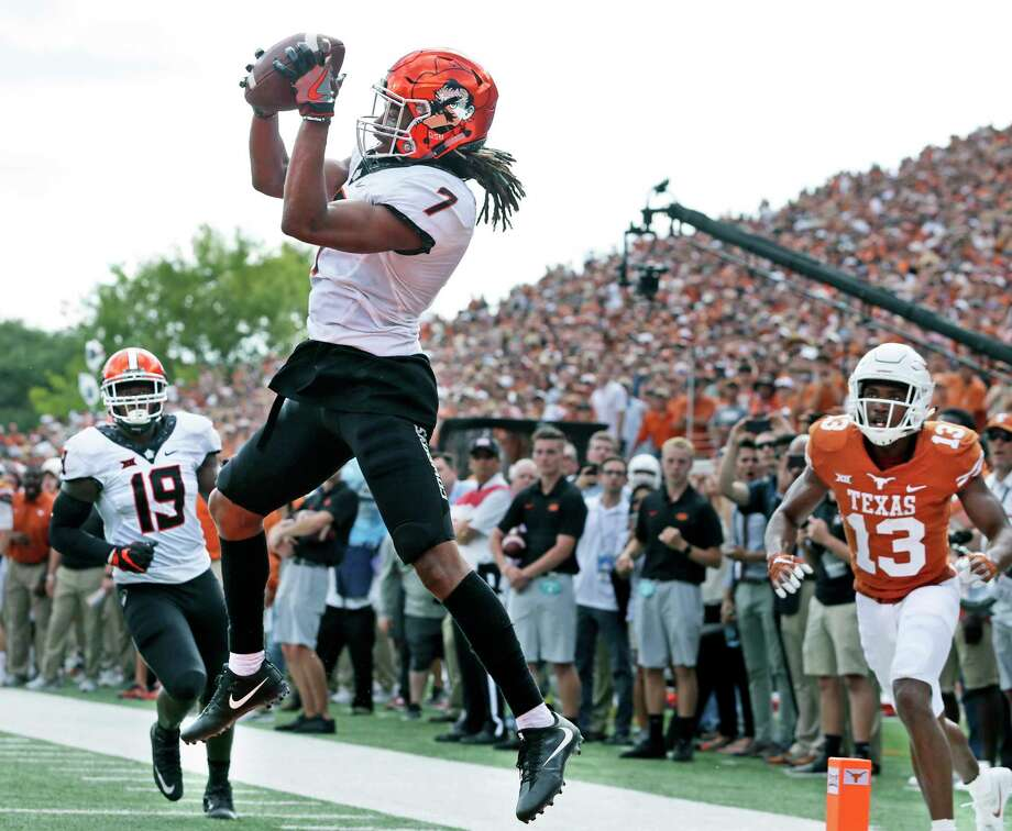 It's easy pickings for safety Ramon Richards as he clinches Oklahoma State's victory by making an interception in the end zone in overtime Saturday. Photo: Tom Reel, Staff / 2017 SAN ANTONIO EXPRESS-NEWS