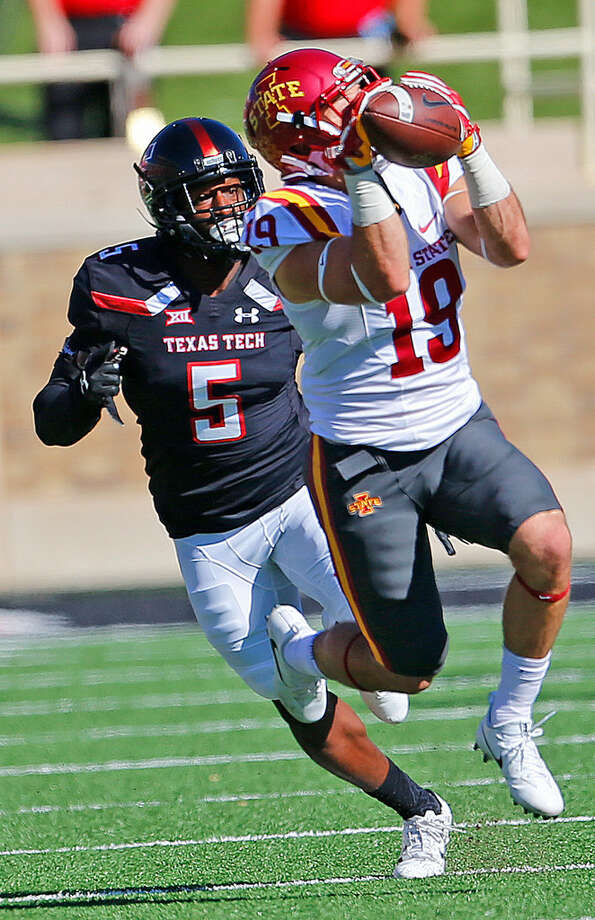 Iowa State wide receiver Trever Ryen (19) hauls in a pass as Texas Tech defensive back Octavious Morgan (5) tries to defends on Saturday at Jones AT&T Stadium. Wade Clay/Special to the Reporter-Telegram.