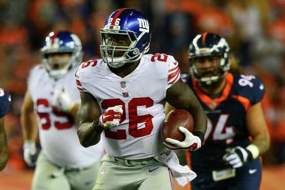 DENVER, CO - OCTOBER 15:  Running back Orleans Darkwa #26 of the New York Giants breaks out for a long run against the Denver Broncos in the second quarter of a game at Sports Authority Field at Mile High on October 15, 2017 in Denver, Colorado. (Photo by Dustin Bradford/Getty Images) ORG XMIT: 700070686 Photo: Dustin Bradford / 2017 Getty Images