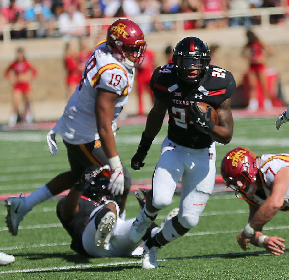 Texas Tech running back Tre King (24) breaks through the Iowa State line for a gain on Saturday at Lubbock's Jones AT&T Stadium. Wade Clay/Special to the Reporter-Telegram.
