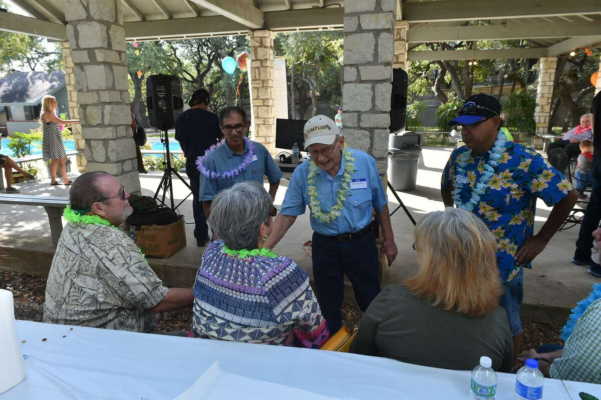 Former foster home director Leland Hacker greets former foster children and guests during a reunion and birthday celebration in his honor at Churchill Estates.