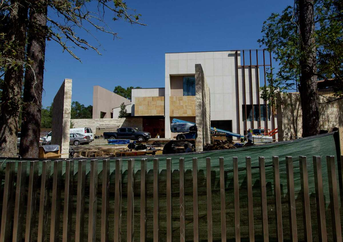 A home in the Grogan's Point neighborhood of The Woodlands has neighbors at a boiling point over the congestion, noise and dirt the homeowner's construction has brought since it began in 2013.