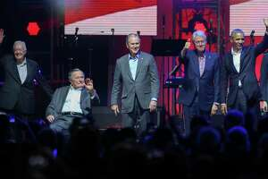 """Former Presidents Jimmy Carter, from left, George H.W. Bush, George W. Bush, Bill Clinton and Barack Obama wave at the audience while attending the """"?Deep From the Heart: The One America Appeal? Concert"""" at Texas A&M? University's Reed Arena  Saturday, Oct. 21, 2017, in College Station. All proceeds from the concert will go to the special hurricane recovery effort benefiting Texas, Florida, and the Caribbean."""