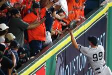 New York Yankees right fielder Aaron Judge (99) catches a ball hit by Houston Astros first baseman Yuli Gurriel (10) off the wall during the second inning as the Houston Astros take on the New York Yankees in Game 7 of the ALCS at Minute Maid Park Saturday, Oct. 21, 2017 in Houston.