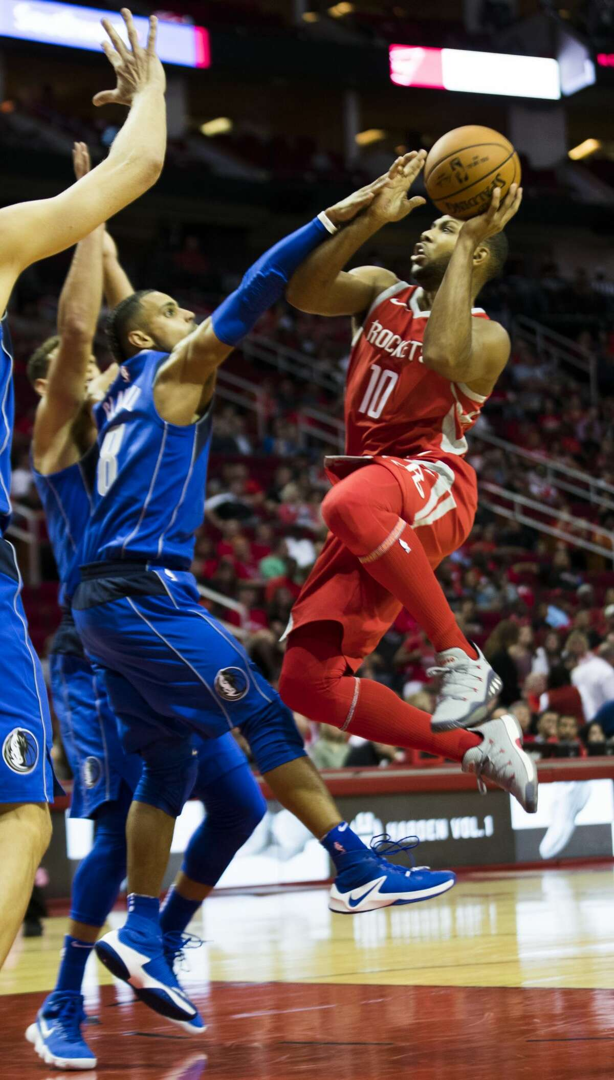 Houston Rockets guard Eric Gordon (10) flies toward the basket scoring against the Dallas Mavericks during the second quarter, Saturday, Oct. 21, 2017, at the Toyota Center in Houston. ( Marie D. De Jesus / Houston Chronicle )