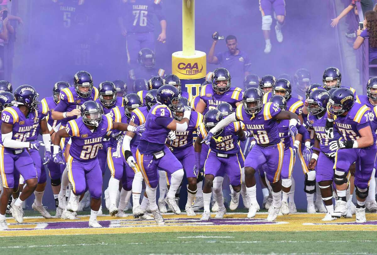 The Albany Great Danes take the field during an NCAA college football game against the Maine Black Bears on Saturday, Oct. 21, 2017, in Albany, N.Y. (Hans Pennink / Special to the Times Union) ORG XMIT: HP111