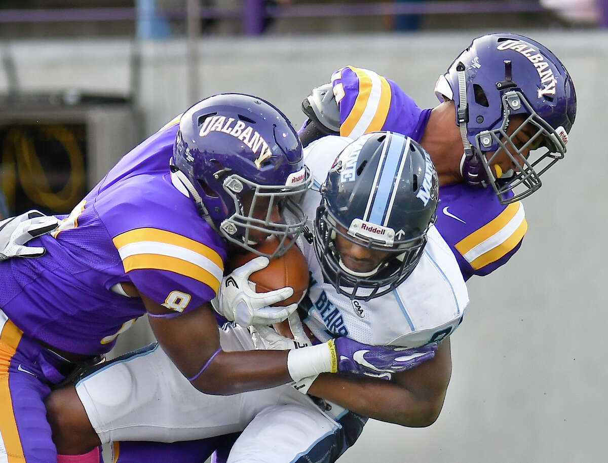 Albany Great Danes safety Mason Gray (8) and linebacker Eli Mencer (12) tackle Maine Black Bears wide receiver Earnest Edwards (81)during the first half of an NCAA college football game on Saturday, Oct. 21, 2017, in Albany, N.Y. (Hans Pennink / Special to the Times Union) ORG XMIT: HP118