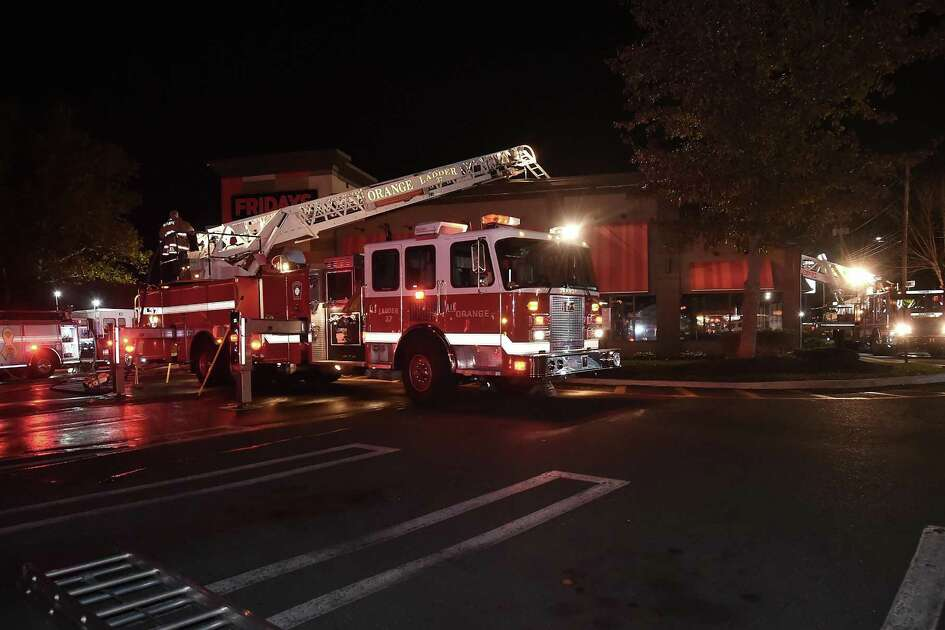 Orange and Woodbridge firefighters at the scene of a fire at Friday's on the Boston Post Road in Orange, Saturday, October 21, 2017.