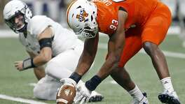 UTSA Roadrunners defensive end Marcus Davenport (93) picks up a fumble by Rice Owls quarterback Sam Glaesmann (4), rear, during first half action Saturday Oct. 21, 2017 at the Alamodome. Davenport scored a touchdown on the play.