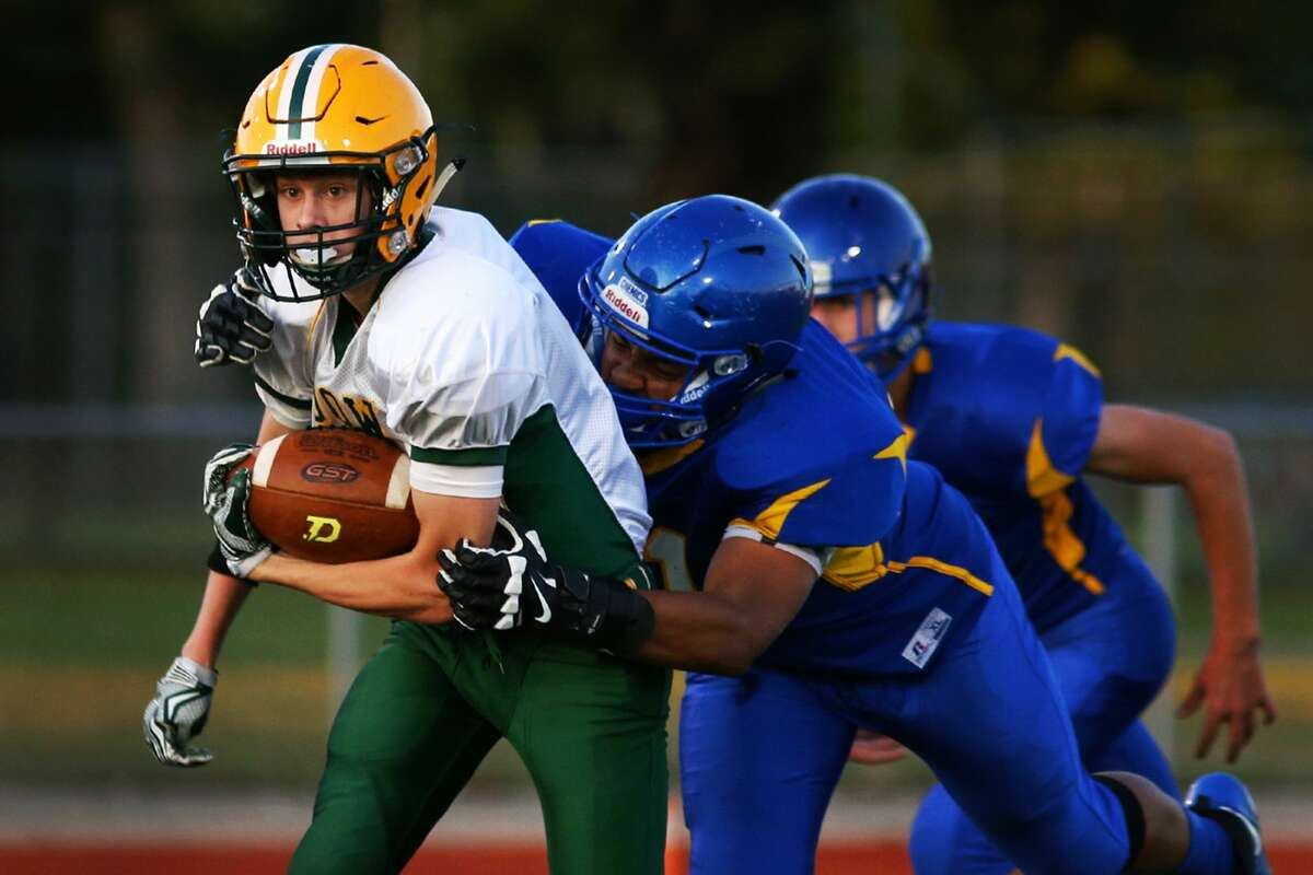 Dow's Owen McCaffrey (8) runs the ball during the game against Midland at Midland High School on Oct. 19, 2017. (Samantha Madar/for the Midland Daily News)