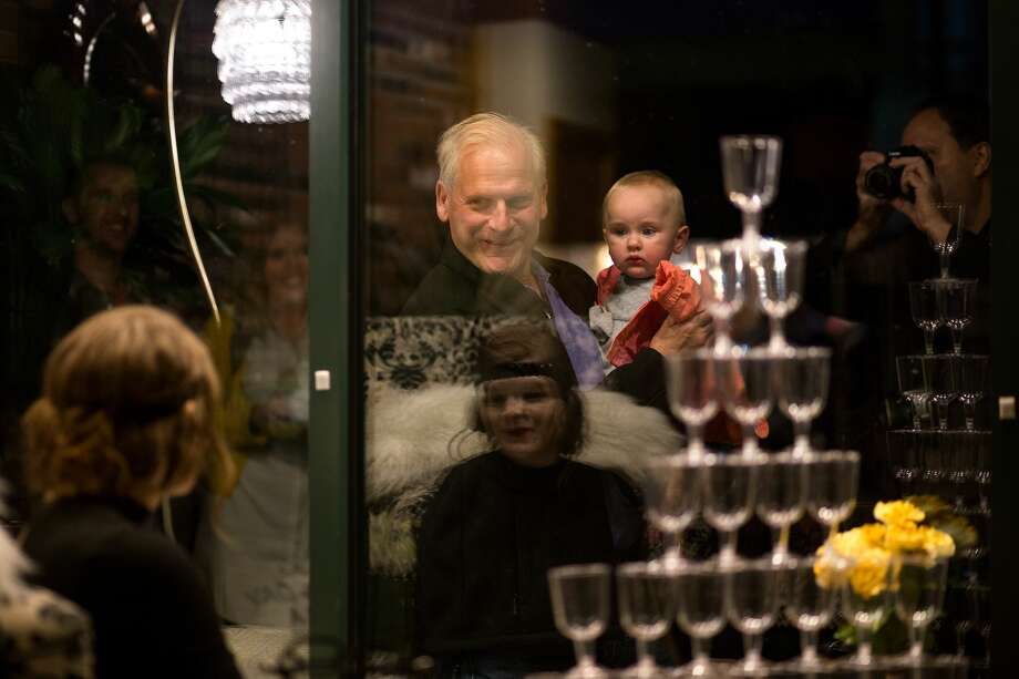 Frank Messner and his granddaughter Madison admire Delanie Frazier, 19, as she holds her pose during the annual Mannequin Night on Oct. 19, 2017. (Samantha Madar/for the Midland Daily News) Photo: (Samantha Madar/for The Midland Daily News)