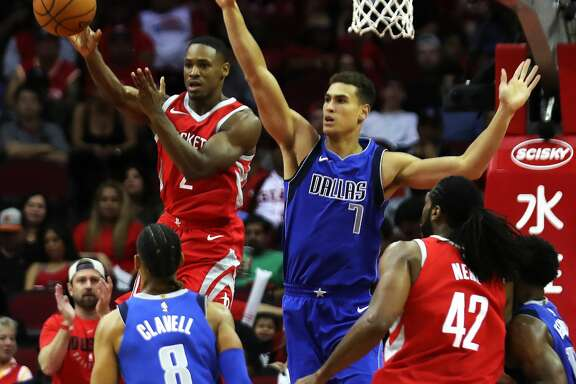 Houston Rockets guard Demetrius Jackson (2) makes a pass under the pressure of Dallas Mavericks forward Dwight Powell (7) during the second half of the game Saturday, Oct. 21, 2017, at the Toyota Center in Houston. ( Marie D. De Jesus / Houston Chronicle )