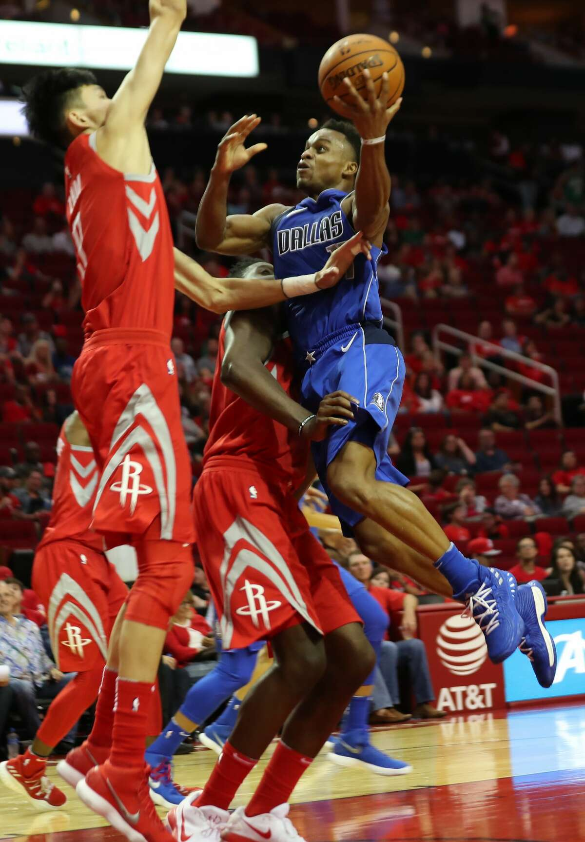 Dallas Mavericks guard Yogi Ferrell (11) shoots the ball under the pressure of Houston Rockets forward Zhou Qi (9) during the second half of the game, Saturday, Oct. 21, 2017, at the Toyota Center in Houston. ( Marie D. De Jesus / Houston Chronicle )