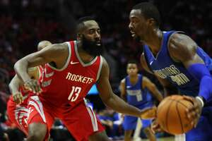 Houston Rockets guard James Harden (13) plays defense against Dallas Mavericks forward Harrison Barnes (40) during the second half of the game between the two Texas city, Saturday, Oct. 21, 2017, at the Toyota Center in Houston. ( Marie D. De Jesus / Houston Chronicle )