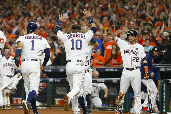 Houston Astros first baseman Yuli Gurriel (10) celebrates after coming home on a double by Houston Astros catcher Brian McCann (16) in the fifth inning of Game 7 of the ALCS at Minute Maid Park on Saturday, Oct. 21, 2017, in Houston. ( Brett Coomer / Houston Chronicle )