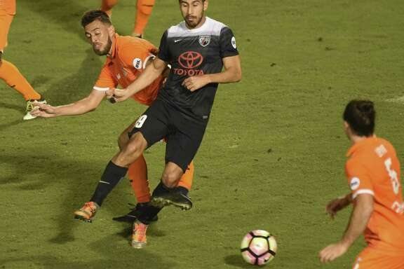 Ever Guzman (99) of San Antonio FC battles Jaime Ayala of Tulsa Roughnecks FC during first-half USL playoffs action at Toyota Field on Saturday, Oct. 21, 2017.