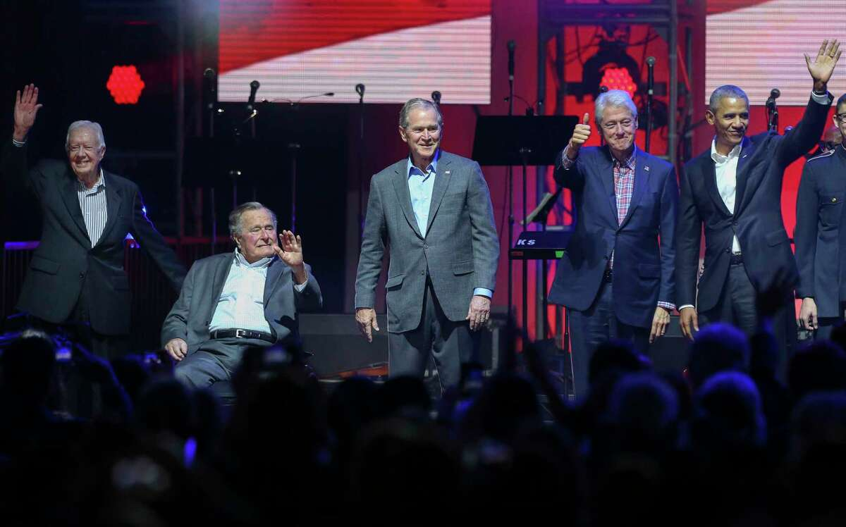 Former presidents Jimmy Carter, from left, George H.W. Bush, George W. Bush, Bill Clinton and Barack Obama wave at the crowd during the