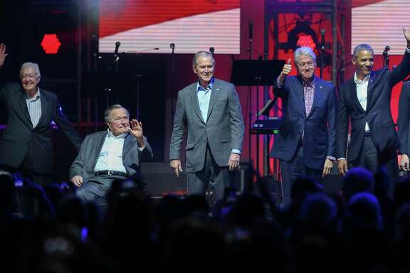 "Former presidents Jimmy Carter, from left, George H.W. Bush, George W. Bush, Bill Clinton and Barack Obama wave at the crowd during the ""Deep From the Heart: The One America Appeal Concert"" at Texas A&M University's Reed Arena on Saturday."