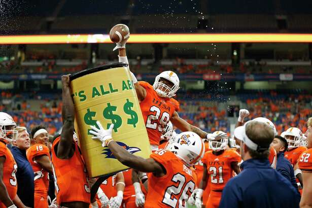 UTSA Roadrunners cornerback Clayton Johnson (29) celebrates with teammates on the sidelines after making an interception during second half action against the Rice Owls Saturday Oct. 21, 2017 at the Alamodome. The UTSA Roadrunners won 20-7.
