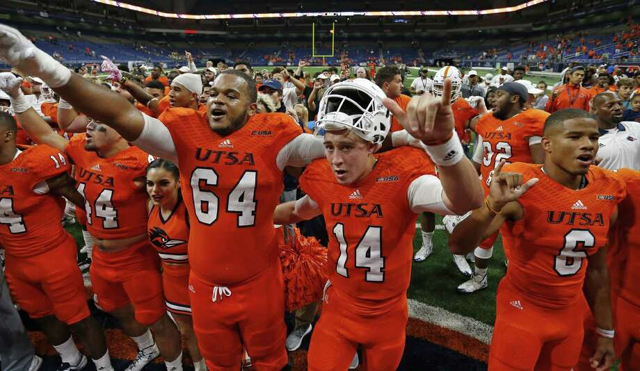 UTSA Roadrunners' Josh Dunlop (64), from left, Dalton Sturm (14), Frank Harris (6) and teammates sing the school song after the game against the Rice Owls Saturday Oct. 21, 2017 at the Alamodome. The UTSA Roadrunners won 20-7. Photo: Edward A. Ornelas, Staff / San Antonio Express-News / © 2017 San Antonio Express-News