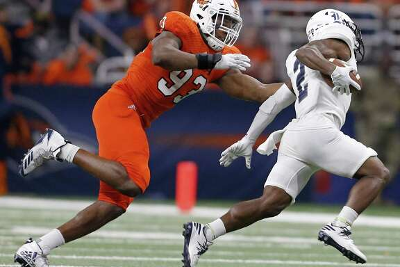 UTSA Roadrunners defensive end Marcus Davenport (93) tackles Rice Owls running back Austin Walter during second half action Saturday Oct. 21, 2017 at the Alamodome. The UTSA Roadrunners won 20-7.